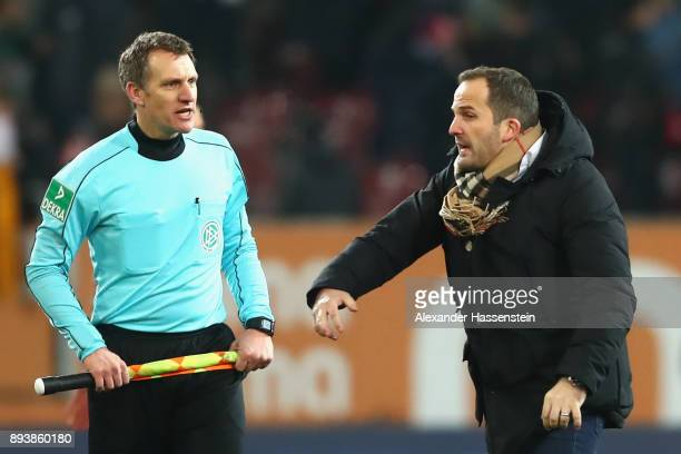 Manuel Baum head coach of Augsburg talks to assietnt referee Tobias Christ after the Bundesliga match between FC Augsburg and SportClub Freiburg at...