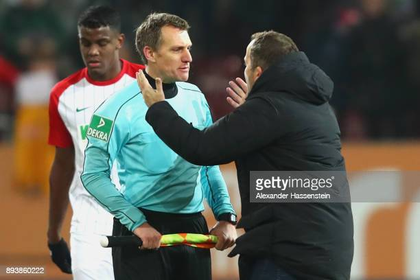 Manuel Baum head coach of Augsburg talks to assistent referee Tobias Christ after the Bundesliga match between FC Augsburg and SportClub Freiburg at...