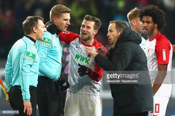 Manuel Baum head coach of Augsburg talks to assistent referee Tobias Christ and referee Chrsitian Dingert after the Bundesliga match between FC...