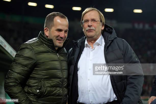 Manuel Baum Head Coach of FC Augsburg talks to Rainer Koch den Vize President of the DFB Cup prior to the match between FC Augsburg and RB Leipzig at...