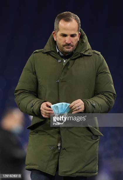 Manuel Baum, Head Coach of FC Schalke 04 is seen holding a face mask prior to the Bundesliga match between FC Schalke 04 and Sport-Club Freiburg at...