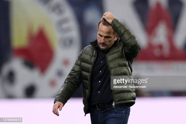 Manuel Baum, Head Coach of FC Schalke 04 looks dejected following his team's defeat in the Bundesliga match between RB Leipzig and FC Schalke 04 at...