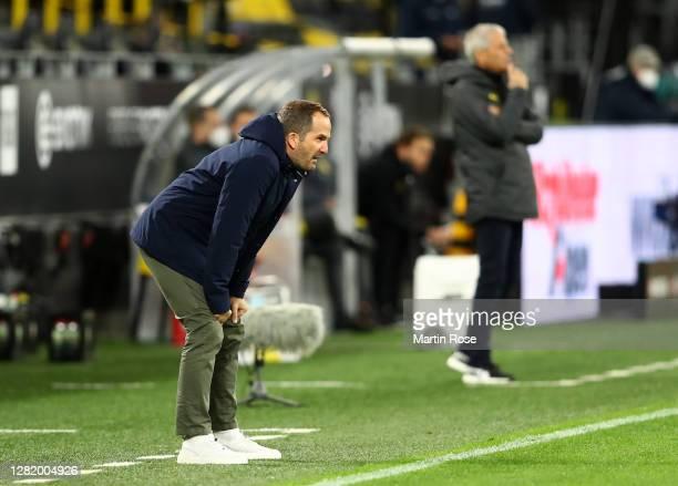 Manuel Baum, Head Coach of FC Schalke 04 reacts during the Bundesliga match between Borussia Dortmund and FC Schalke 04 at Signal Iduna Park on...