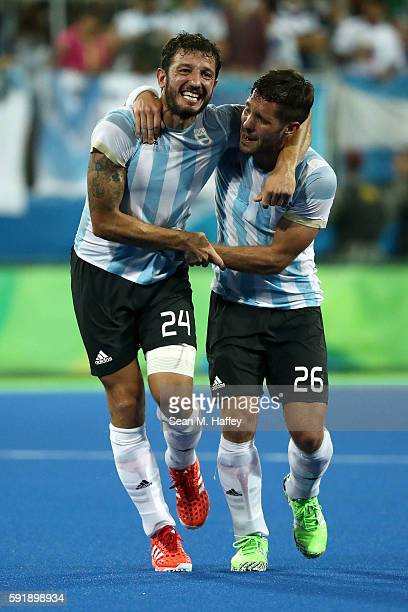 Manuel Brunet of Argentina and Agustin Mazzilli of Argentina celebrate winning the Men's Hockey Gold Medal match between Belgium and Argentina on Day...