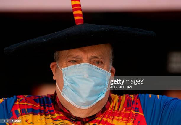 Manuel Caceres Artesero also known as Manolo El del Bombo poses wearing a face mask in his bar which will close soon as he is due to retire in...