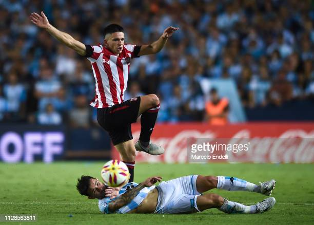 Manuel Castro of Estudiantes fights for the ball with Eugenio Mena of Racing Club during a match between Racing Club and Estudiantes as part of...