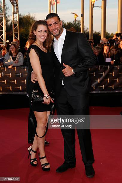 Manuel Charr and friend Amira attend the Deutscher Fernsehpreis 2013 Red Carpet Arrivals at Coloneum on October 02 2013 in Cologne Germany
