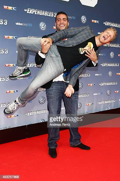 Manuel Charr and Oliver Pocher attend the German premiere of the film 'The Expendables 3' at Residenz Kino on August 6 2014 in Cologne Germany