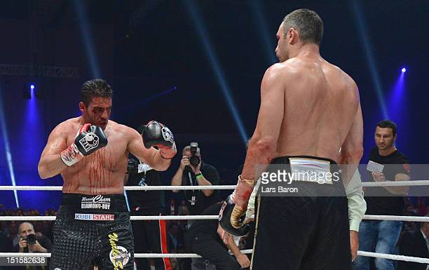 Manuel Charr of Germany argues with Vitali Klitschko of Ukraine after loosing the WBCheavy weight title fight between Vitali Klitschko of Ukraine and...