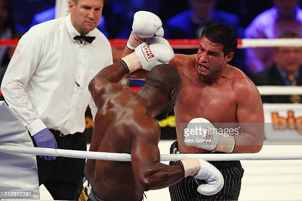 Manuel Charr of Germany hits Danny Williams of England during their heavyweight fight ahead of the WBA middleweight World Championship fight between...