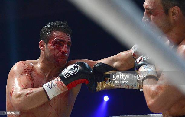 Manuel Charr of Germany punshes Vitali Klitschko of Ukraine during the WBCheavy weight title fight between Vitali Klitschko of Ukraine and Manuel...