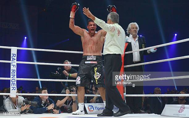 Manuel Charr of Germany reacts after referee Guido Cavalleri of Italy and doctor Stefan Holthusen finished the WBCheavy weight title fight between...