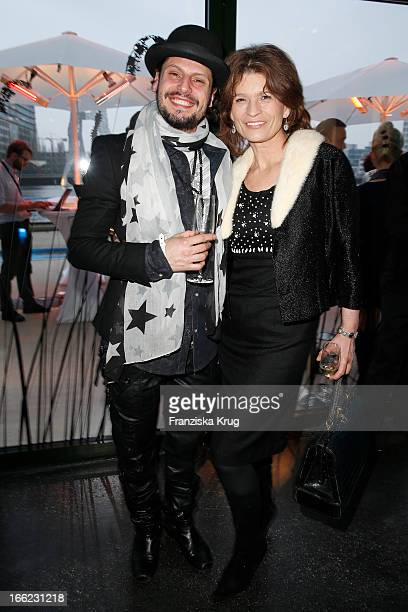 Manuel Cortez and Gabrielle Scharnitzky attend the Guido Maria Kretschmer For eBay Collection Launch at Label 2 on April 10 2013 in Berlin Germany