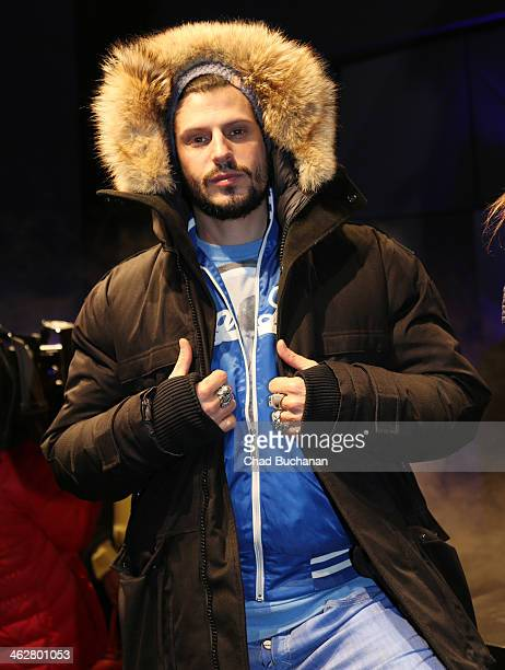 Manuel Cortez models a jacket at the Nobis Fashion show during MercedesBenz Fashion Week Autumn/Winter 2014/15 at Microsoft Berlin on January 15 2014...