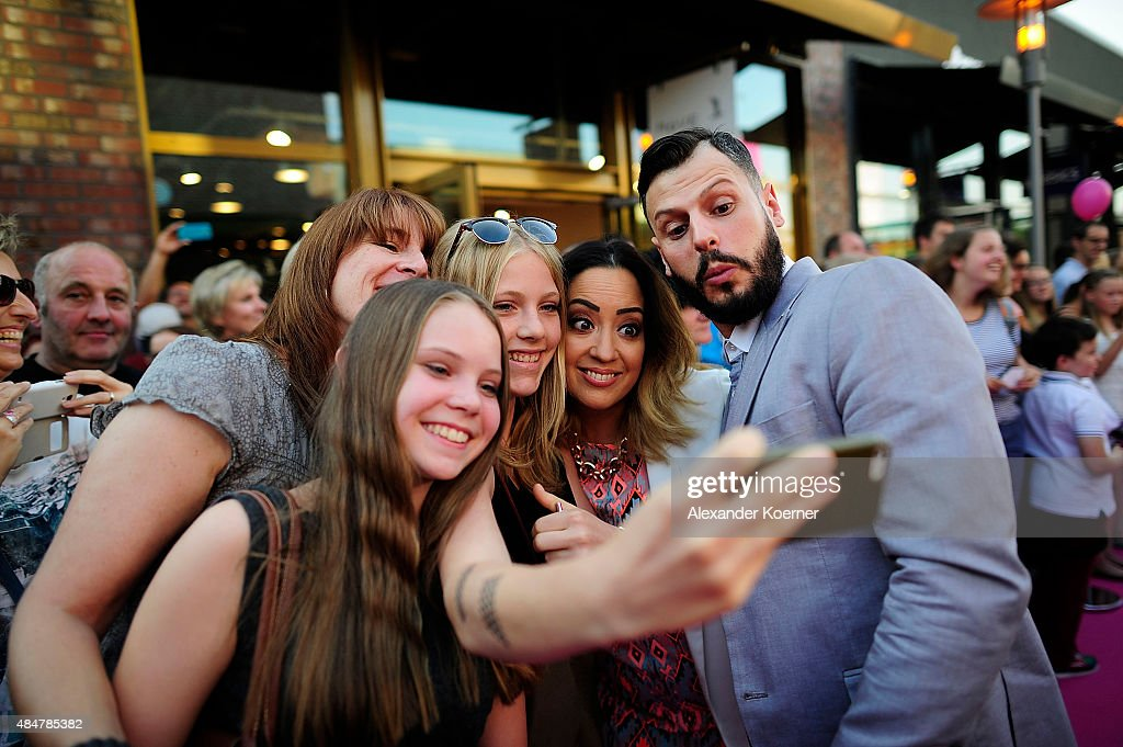 Manuel Cortez takes a «selfie« with fans while attending the Late Night Shopping at Designer Outlet Soltau on August 21, 2015 in Soltau, Germany.