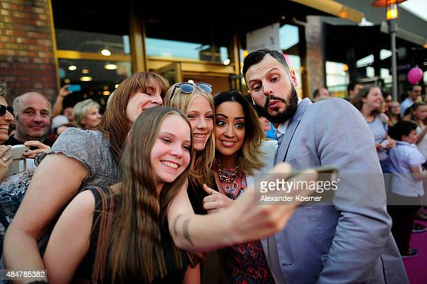 Manuel Cortez takes a «selfie« with fans while attending the Late Night Shopping at Designer Outlet Soltau on August 21 2015 in Soltau Germany