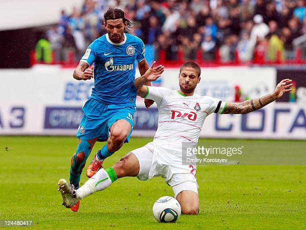 Manuel da Costa of FC Lokomotiv Moscow battles for the ball with Danny of FC Zenit St Petersburg during the Russian Premier League match between FC...