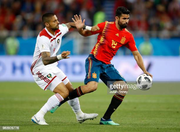 Manuel Da Costa of Morocco battles with Diego Costa of Spain during the 2018 FIFA World Cup Russia group B match between Spain and Morocco at...