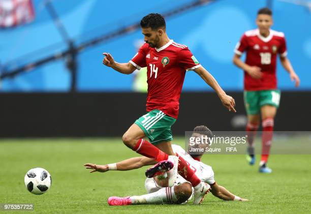 Manuel Da Costa of Morocco is fouled by Ramin Rezaeian of Iran during the 2018 FIFA World Cup Russia group B match between Morocco and Iran at Saint...