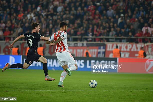 Manuel da Costa of Olympiacos vies for the ball in front of Angelo Henriquez of Dinamo Zagreb