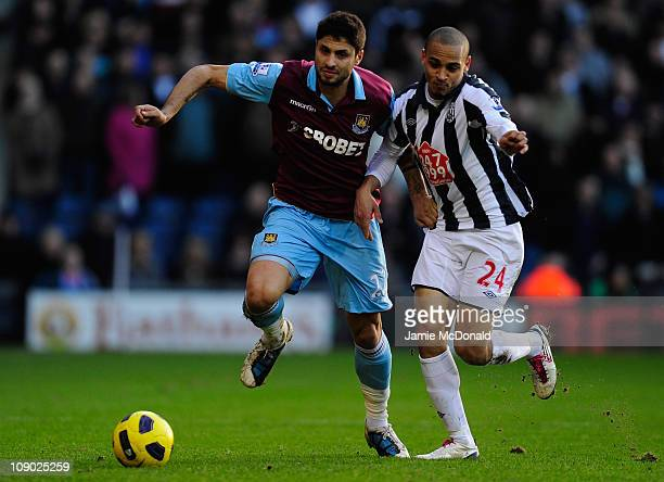 Manuel Da Costa of West Ham United battles with Peter Odemwingie of West Bromwich Albion during the Barclays Premiership match between West Bromwich...