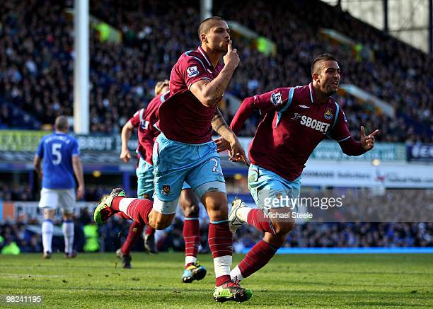 Manuel Da Costa of West Ham United celebrates scoring an equalising goal with team mate Mido during the Barclays Premier League match between Everton...