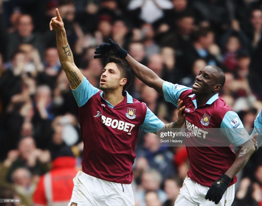 Manuel da Costa (L) of West Ham United celebrates with team mate Demba Ba (R) after scoring during the Barclays Premier League match between West Ham United and Stoke City at the Boleyn Ground on March 5, 2011 in London, England.