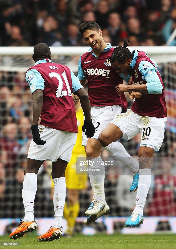 Manuel da Costa (C) of West Ham United celebrates with team mate Demba Ba (L) and Frederic Piquionne (R) after scoring during the Barclays Premier League match between West Ham United and Stoke City at the Boleyn Ground on March 5, 2011 in London, England.