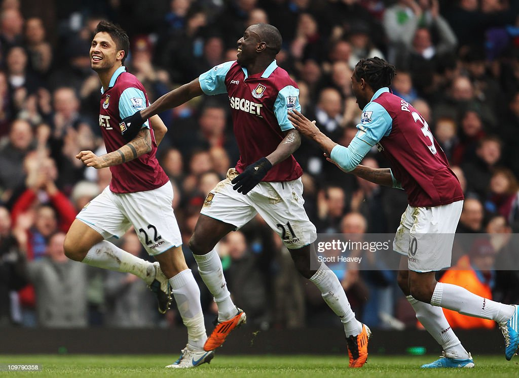 Manuel da Costa (L) of West Ham United celebrates with team mates Demba Ba (C) and Frederic Piquionne (R) after scoring during the Barclays Premier League match between West Ham United and Stoke City at the Boleyn Ground on March 5, 2011 in London, England.