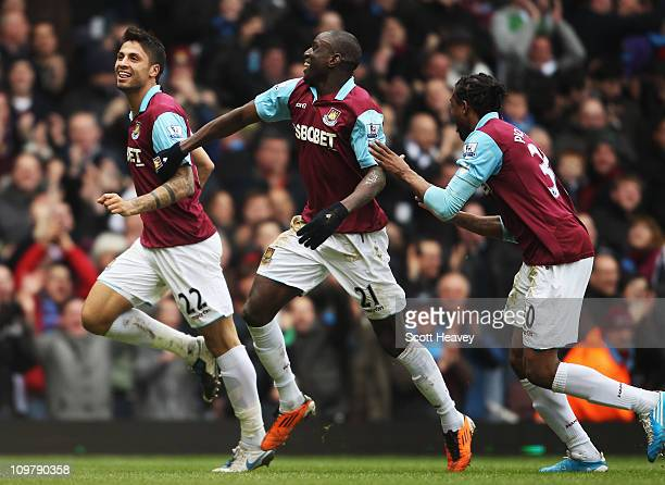 Manuel da Costa of West Ham United celebrates with team mates Demba Ba and Frederic Piquionne after scoring during the Barclays Premier League match...