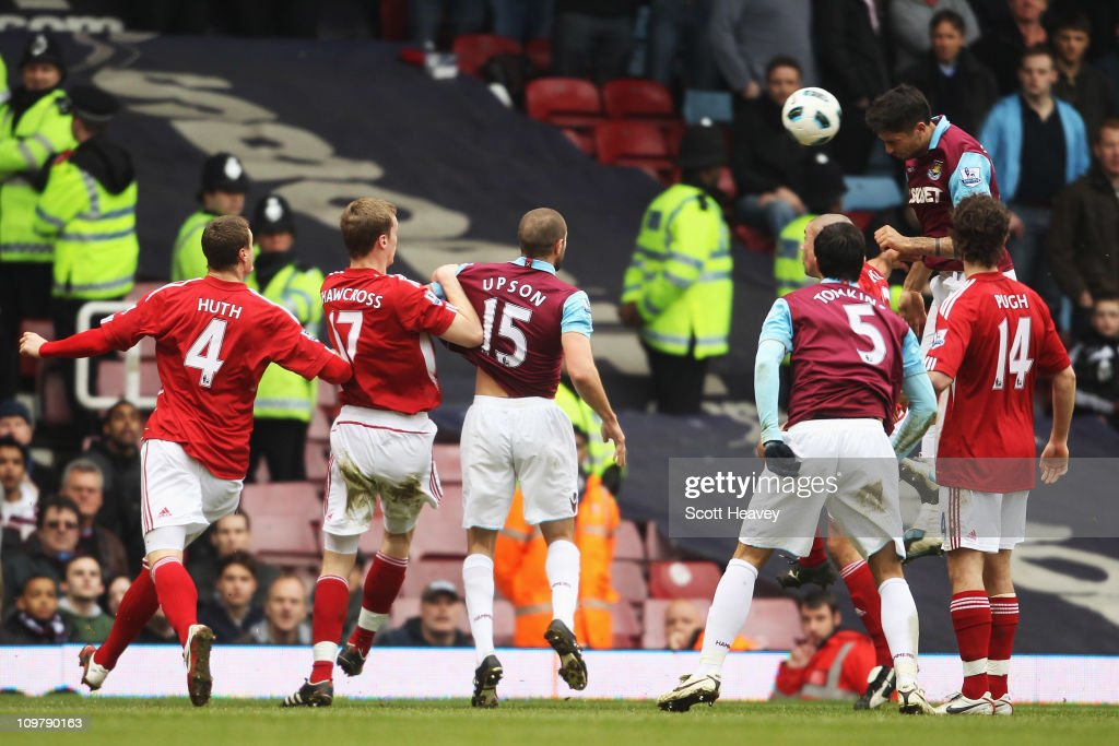 Manuel da Costa (R) of West Ham United rises above the Stoke City defence to score his sides second goal during the Barclays Premier League match between West Ham United and Stoke City at the Boleyn Ground on March 5, 2011 in London, England.
