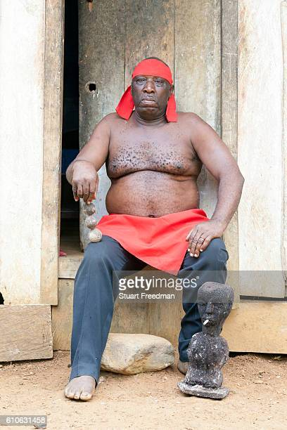 Manuel da Cruz a Curandeiro or traditional healer at his home Sao Tome The curandero dedicates their life to the administration of remedies for...