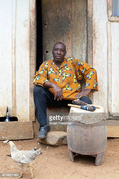 Manuel da Cruz, a Curandeiro or traditional healer at his home, Sao Tome. The curandero dedicates their life to the administration of remedies for...