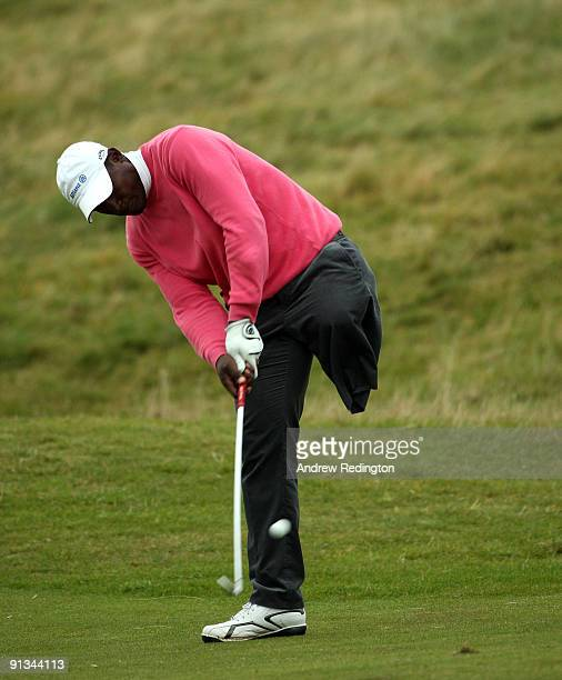 Manuel De Los Santos of the Dominican Republic hits his second shot on the second hole during the second round of The Alfred Dunhill Links...