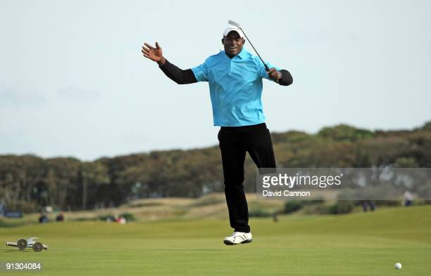 Manuel De Los Santos of the Dominican Republic leaps as he just misses a birdie putt at the 9th hole during the first round of the Alfred Dunhill...