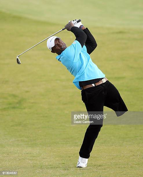 Manuel De Los Santos of the Dominican Republic plays his second shot at the par 5 9th hole during the first round of the Alfred Dunhill Links...