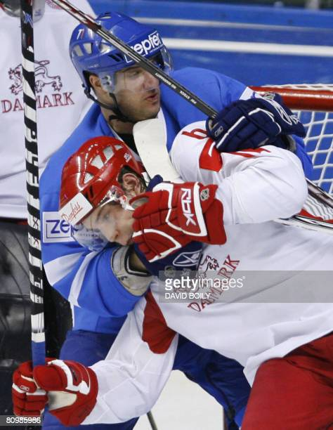 Manuel de Toni of Italy grapples with Stefan Lassen of Denmark in the second period during the preliminary round at the 2008 IIHF World Championships...