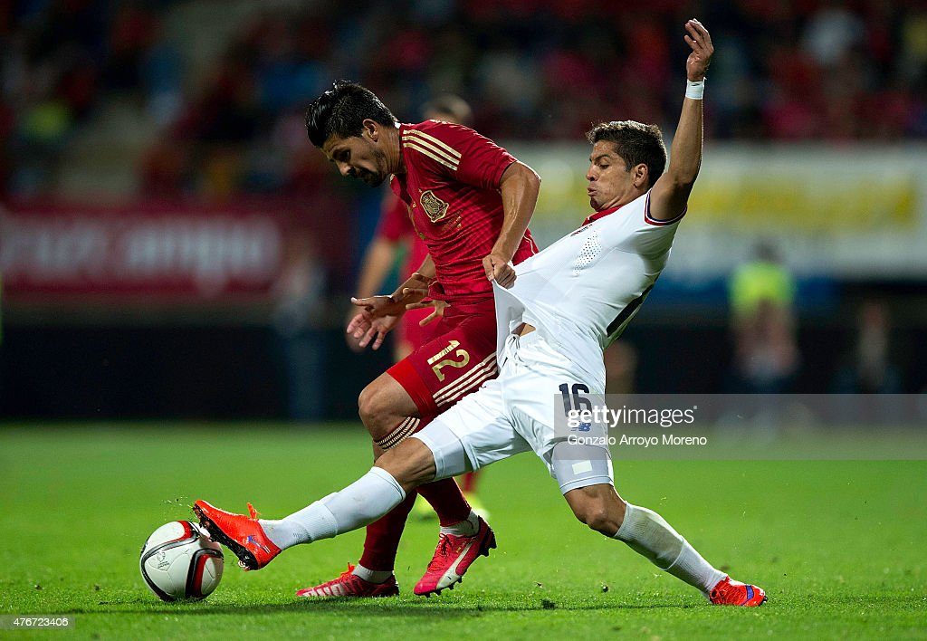 Manuel Duran alias Nolito (L) of Spain competes for the ball with Cristian Gamboa (R) of Costa Rica during the international friendly match between Spain and Costa Rica at Reino de Leon Stadium on June 11, 2015 in Leon, Spain.