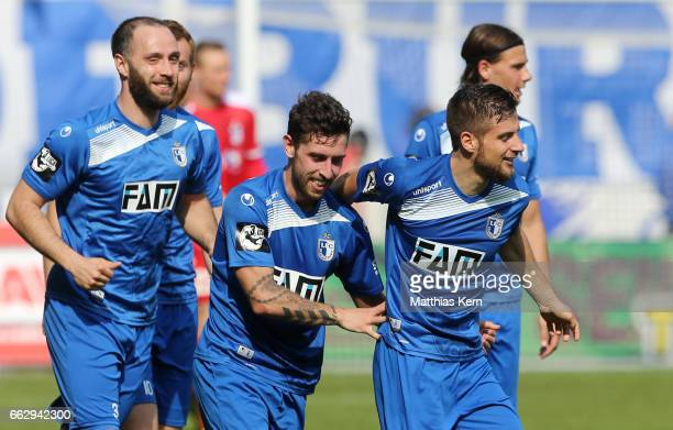 Manuel Farrona Pulido of Magdeburg celebrates with team mates after scoring his teams first goal during the third league match between 1FC Magdeburg...