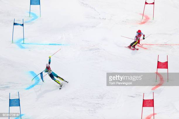 Manuel Feller of Austria and Andre Mhyrer of Sweden compete during the Alpine Team Event Quarterfinals on day 15 of the PyeongChang 2018 Winter...