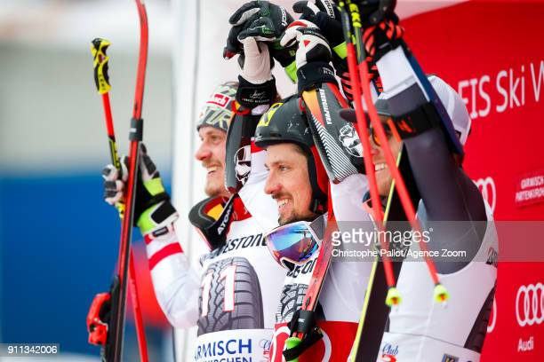 Manuel Feller of Austria takes 2nd place Marcel Hirscher of Austria takes 1st place Ted Ligety of USA takes 3rd place during the Audi FIS Alpine Ski...