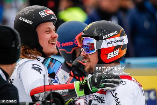 Manuel Feller of Austria takes 2nd place Marcel Hirscher of Austria takes 1st place during the Audi FIS Alpine Ski World Cup Men's Giant Slalom on...