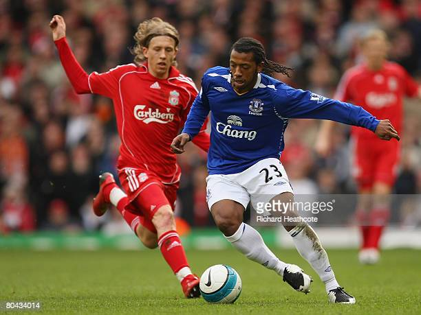 Manuel Fernandes of Everton is pursued by Lucas of Liverpool during the Barclays Premier League match between Liverpool and Everton at Anfield on...