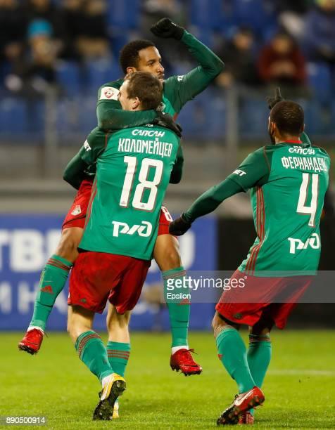 Manuel Fernandes of FC Lokomotiv Moscow celebrates his goal with Aleksandr Kolomeytsev and Manuel Fernandes during the Russian Football League match...