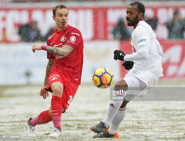 Manuel Fernandes of FC Lokomotiv Moscow vies for the ball with Andrey Yeshchenko of FC Spartak Moscow during the Russian Premier League match between...
