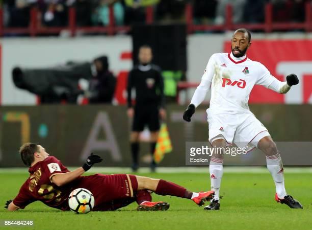 Manuel Fernandes of FC Lokomotiv Moscow vies for the ball with Maksim Kanunnikov of FC Rubin Kazan during the Russian Premier League match between FC...