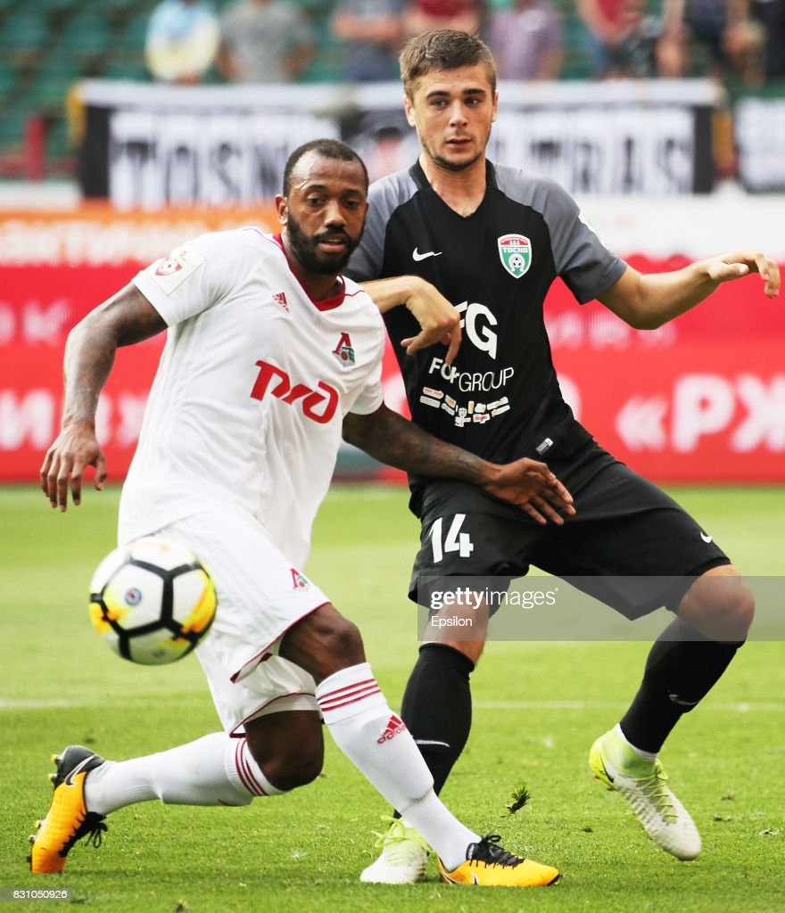 Manuel Fernandes of FC Lokomotiv Moscow vies for the ball with Alyaksandr Karnitsky of FC Tosno Khabarovsk during the Russian Premier League match between FC Lokomotiv Moscow and FC Tosno at Lokomotiv stadium on August 13, 2017 in Moscow, Russia.