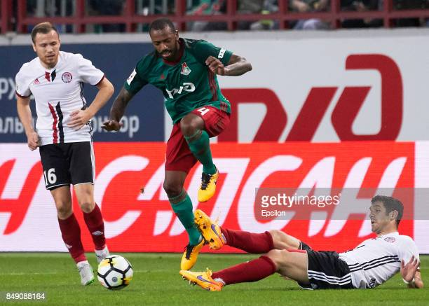 Manuel Fernandes of FC Lokomotiv Moscow vies for the ball with Alexander Milkovich of FC Amkar Perm during the Russian Premier League match between...