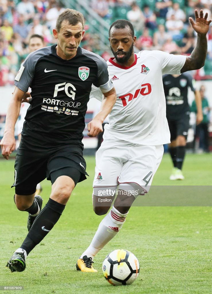 Manuel Fernandes of FC Lokomotiv Moscow vies for the ball with Rustem Mukhametshin of FC Tosno Khabarovsk during the Russian Premier League match between FC Lokomotiv Moscow and FC Tosno at Lokomotiv stadium on August 13, 2017 in Moscow, Russia.