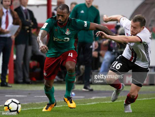 Manuel Fernandes of FC Lokomotiv Moscow vies for the ball with Sergei Balanovichh of FC Amkar Perm during the Russian Premier League match between FC...